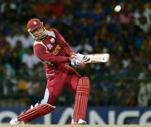 Hitting out...Marlon Samuels blasts his way to a match winning 78 in the World T20 final.