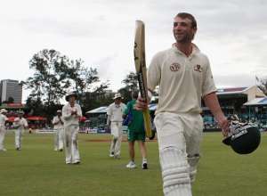 Hughes walks off after scoring back-to-back hundreds in only his second Test match.