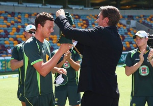 The next generation...Josh Hazelwood receives his Baggy Green from Glenn McGrath.