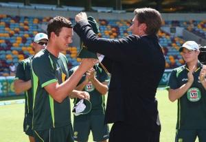 The next generation...Josh Hazelwood receives his Baggy Green from Glenn McGrath.
