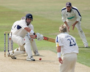 Darren Lehmann sweeps fellow countryman Shane Warne during a county match for Yorkshire.